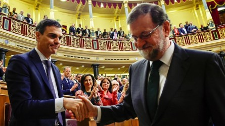 Spain s new Prime Minister and Socialist party PSOE leader Pedro Sanchez shakes hands with ousted Prime Minister Mariano Rajoy after a motion of no confidence vote at parliament in Madrid Spain June 1 2018 Pierre-Philippe Marcou Pool via REUTERS